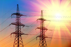 Electric power transmission towers. At sunset royalty free stock photos