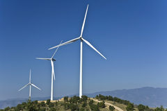 Electric power wind generators on a hill Royalty Free Stock Photos