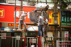 Electric power workers in the maintenance of the transformer Royalty Free Stock Photo