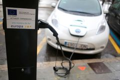 Electric car charging in a public point in palma de mallorca royalty free stock photography
