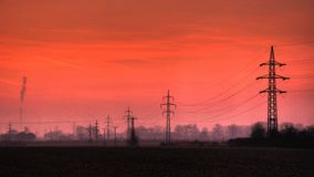 Electric powerline in evening landscape Royalty Free Stock Photography
