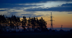 Electric powerline in evening landscape Stock Photography