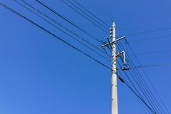 Electric powerline with pole and wire with clear blue sky backgr Royalty Free Stock Photography