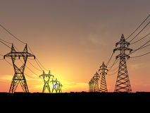 Electric powerlines. Over orange sunrise Stock Photo