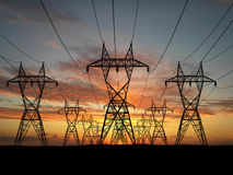 Electric powerlines. 3D Electric powerlines over sunrise Royalty Free Stock Images