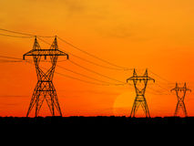 Electric powerlines. 3D Electric powerlines over sunrise Stock Image