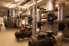 Electric pumps. Two electric powered pumps at the modern biomass cogeneration plant stock photos