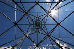 Electric pylon. Upwards view of electric pylon and sun Royalty Free Stock Images