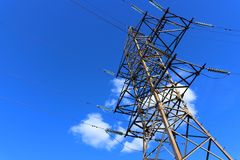 Electric pylon on blue sky royalty free stock images