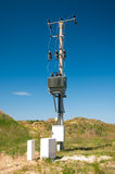 Electric pylon with isolators. On blue sky background Royalty Free Stock Photography
