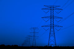 Electric Pylons against blue sky Stock Photos