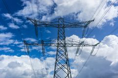 Electric pylons. On the blue sky background Stock Images