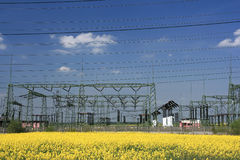 Electric pylons and farmland royalty free stock images