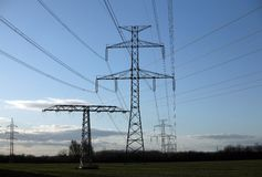 Electric pylons in field Stock Image