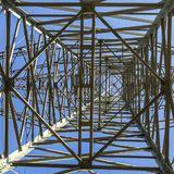Electric pylons transporting electricity through high tension ca Stock Images