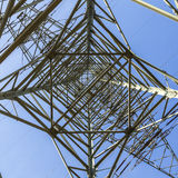 Electric pylons transporting electricity through high tension ca Stock Image