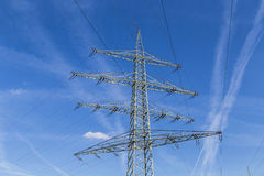 Electric pylons transporting electricity through high tension ca Stock Photography