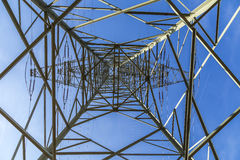 Electric pylons transporting electricity through high tension ca Royalty Free Stock Photography