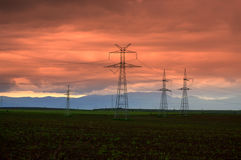 Electric pylons twilight nature Royalty Free Stock Photography