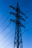 Electric pylons. Vector silhouette of Power lines and electric pylons Stock Photography