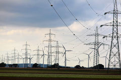 Electric pylons and wind farm Royalty Free Stock Photography