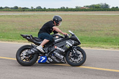 Electric racing motorcycle. The driver Carlo Gelmi riding the electric motorcycle of the italian team Vercar Moto, derived from Yamaha YZF R6, that took part in stock photos