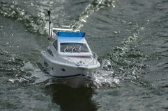 Electric radiocontrolled model boat. Electric radiocontrolled modelboat running in a lake Royalty Free Stock Image
