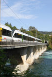 Electric railcars on bridge over River Rhine. Stock Images