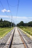 Straight electric railroad. Electric railroad in Niitvälja, Estonia royalty free stock photos