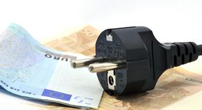 Electric Rates. Plug with insulated euro banknotes Stock Image