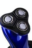 Electric razor. Blue electric razor isolated on white background Stock Image