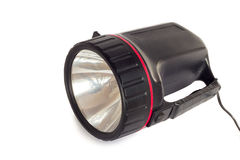 Electric rechargeable led flashlight on a white background. Royalty Free Stock Images