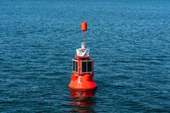 Electric red buoy with solar panel royalty free stock photos