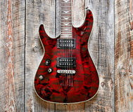 Electric red guitar body on wooden background vintage look Royalty Free Stock Images