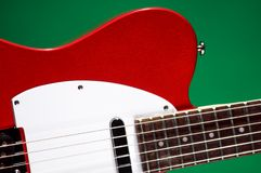 Electric Red Guitar On Green Royalty Free Stock Images