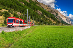 Electric red tourist train,Switzerland,Europe Royalty Free Stock Photography