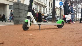 Electric Rental Scooter Lime-S Place Bellecour Lyon France. Lyon, France - January 4, 2019: Lime-S Electric Rental Scooter Parked On Place Bellecour In Lyon stock footage