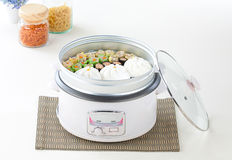 Electric rice cooker. And the tray for steaming food stock photography