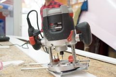 Electric Router Tool. Closeup of an electric router power tool, used in carpentry for finishing edges Stock Image