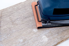 Electric sander on board Stock Photography