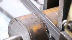 Electric saw on iron. Band saw cuts steel bar stock video