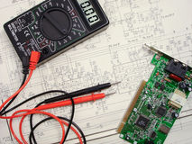 Electric scheme. Electric circuit with a multimeter and the board royalty free stock photo