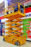 Electric Scissor Lift. Tambov, Russian Federation - December 15, 2013: Electric Scissor Lift Haulotte Compact 12 works in supermarkets. The maximum load capacity Stock Photo