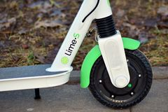 Electric scooter Lime-s on the pavement. Warsaw, Poland. 5 December 2018. Electric scooter Lime-s on the pavement stock images