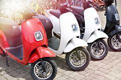 Electric scooters for rent in parking. Electric scooters for rent in the parking lot in sunny weather stock photos