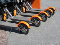 Electric scooters in row on the parking lot royalty free stock photo