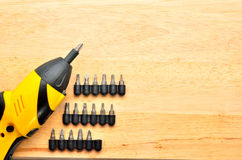 Electric screw driver on wooden floor Royalty Free Stock Images
