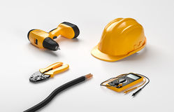 Electric screwdriver, helmet, crimping pliers Royalty Free Stock Photography