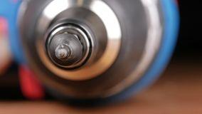 Electric screwdriver. Macro photography moving camera stock video