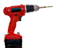 Electric screwdriver with screw. Close up photo of an electric screwdriver with screw Royalty Free Stock Images